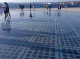 Pozdrowienie Słońca, w tel morze, w Zadarze
